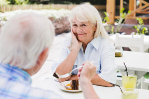 Elderly woman enjoying meal outdoors