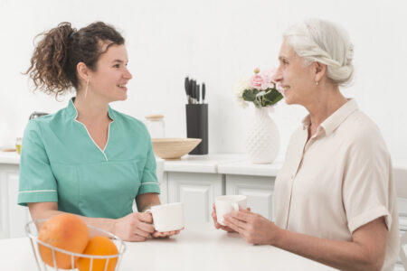 Old woman with nurse discussing menopause treatment